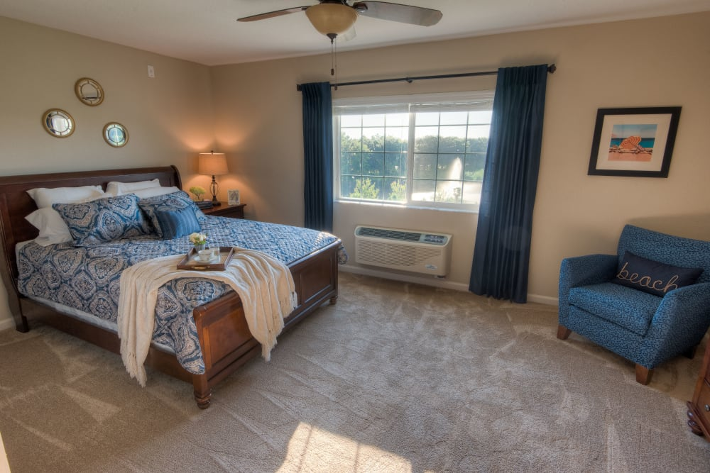 Spacious bedroom with a ceiling fan at Inspired Living at Lakewood Ranch in Bradenton, Florida.