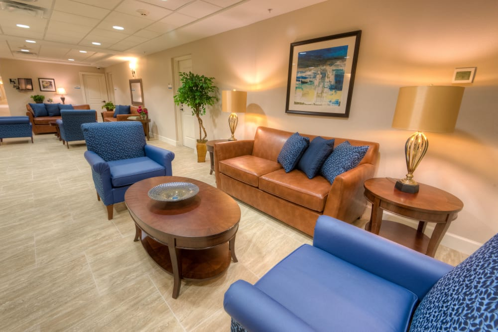 Resident lounge with comfy couches at Inspired Living Lakewood Ranch in Bradenton, Florida.