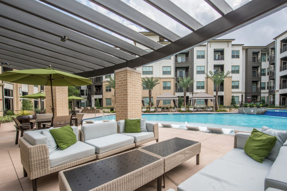 Covered poolside seating at The Abbey at Northpoint in Spring, Texas