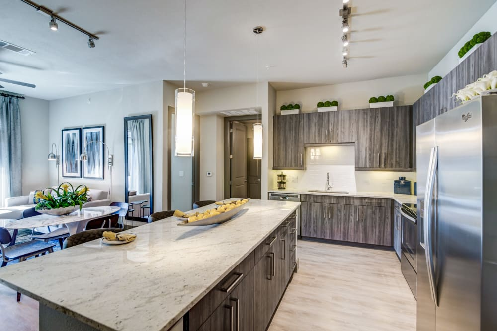 An abundance of cabinet space in an apartment kitchen at The Abbey at Northpoint in Spring, Texas
