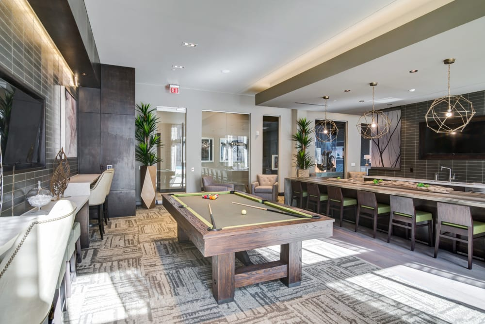 A billiards table for residents at The Abbey at Northpoint in Spring, Texas