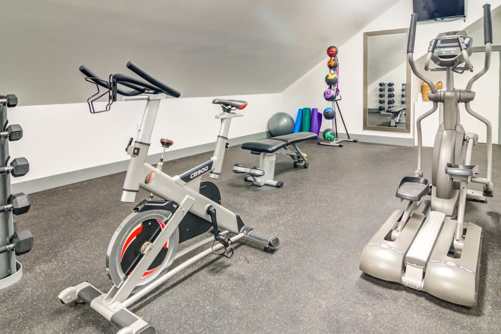 Plenty of equipment for you to use in the onsite fitness center at Sofi Lake Oswego in Lake Oswego, Oregon