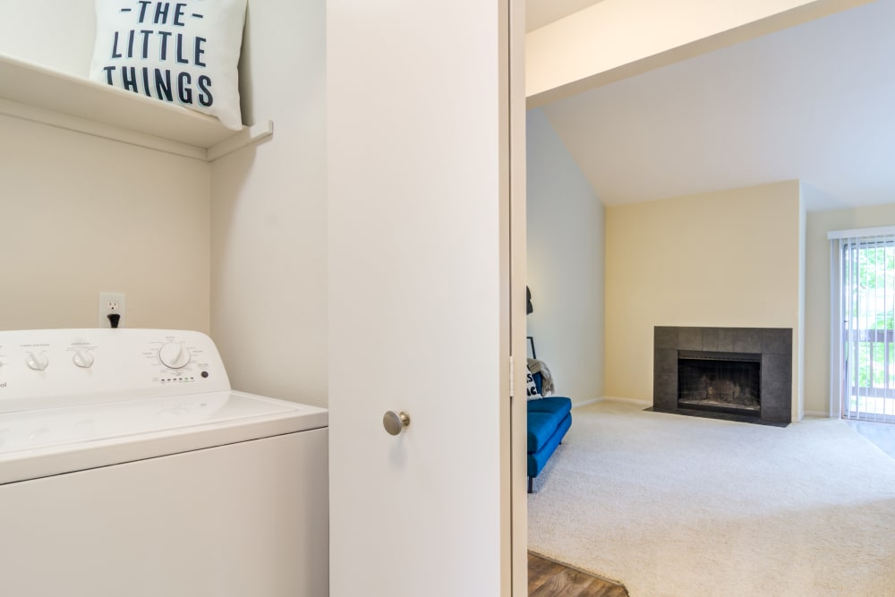 In-unit washer and dryer in a model home at Sofi Lake Oswego in Lake Oswego, Oregon