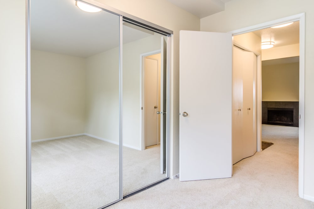 Mirrored closet doors in a model home's master bedroom at Sofi Lake Oswego in Lake Oswego, Oregon