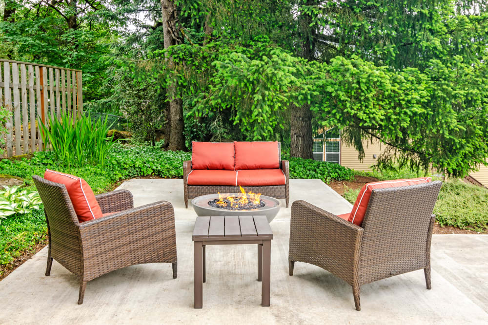 Comfortable seating around the fire pit at Sofi Lake Oswego in Lake Oswego, Oregon