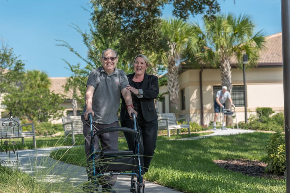 Resident and staff member out for a stroll at Inspired Living Ivy Ridge in St Petersburg, Florida.