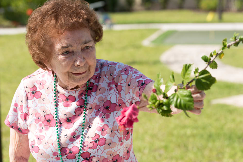 A resident in the garden at Inspired Living Ivy Ridge in St Petersburg, Florida.