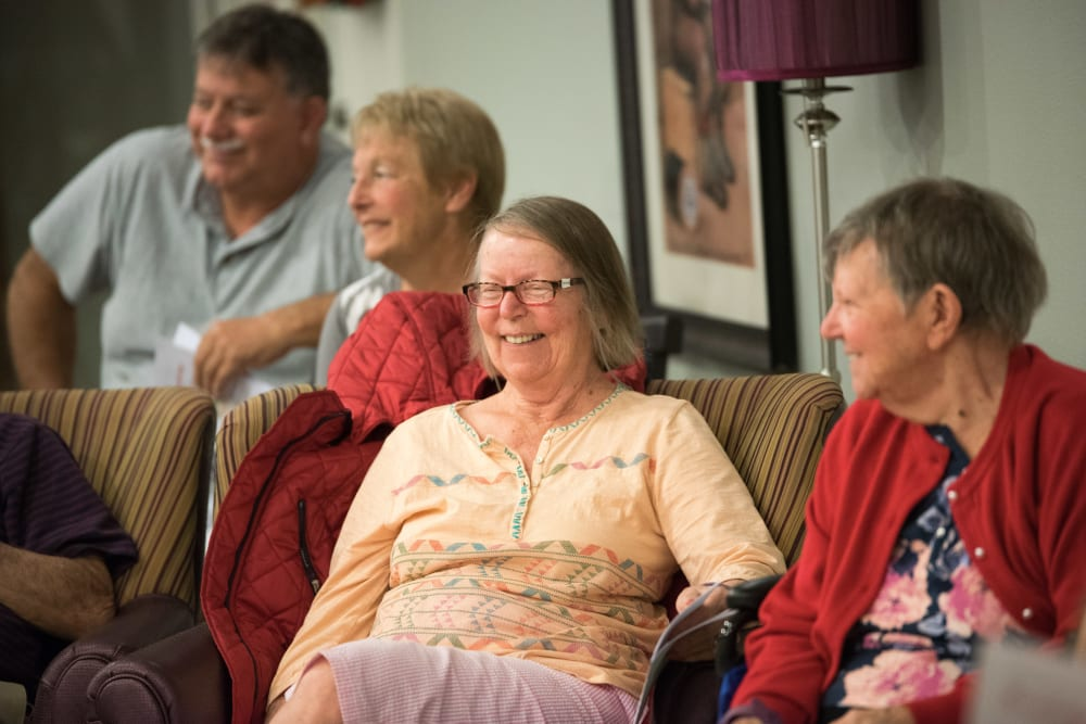 Residents laughing at an event at Inspired Living in Sun City Center, Florida.