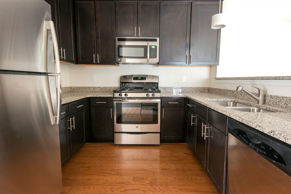 Kitchen with stylish hardwood flooring at Strafford Station Apartments in Wayne, Pennsylvania