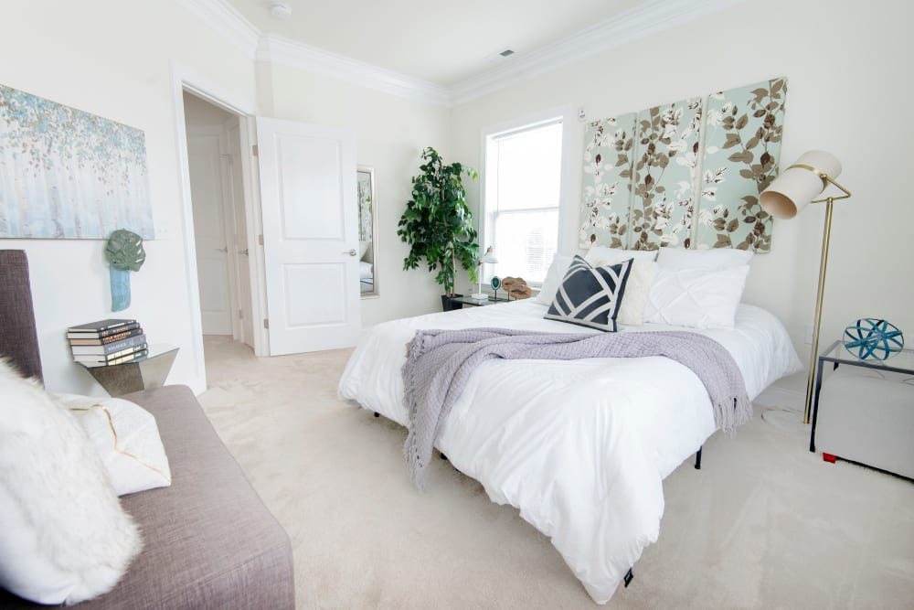 Well decorated master bedroom at Strafford Station Apartments in Wayne, Pennsylvania