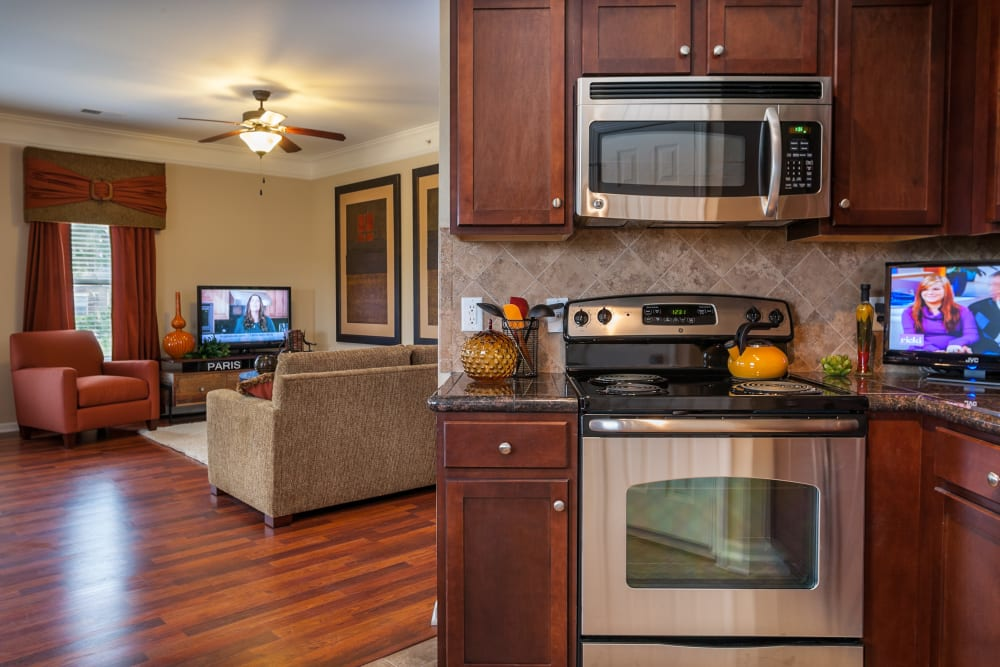 Stainless steel appliances in an apartment kitchen at The Sovereign at Overland Park in Overland Park, Kansas