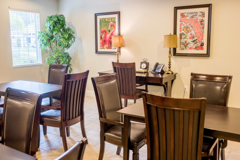 A dining room with wall art at Inspired Living in Sun City Center, Florida.
