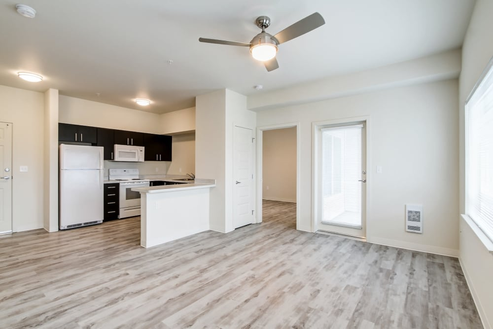 open format living room with kitchen and breakfast counter at LARC at Burien in Burien, WA