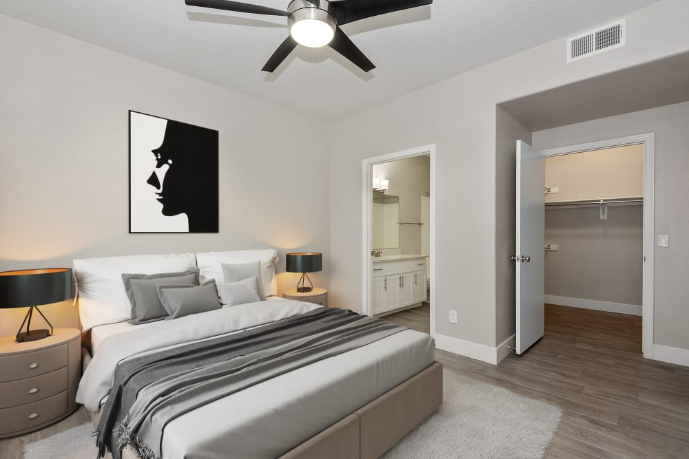 Bedroom with hardwood floor and spacious closet at The Retreat Apartments in Phoenix, AZ