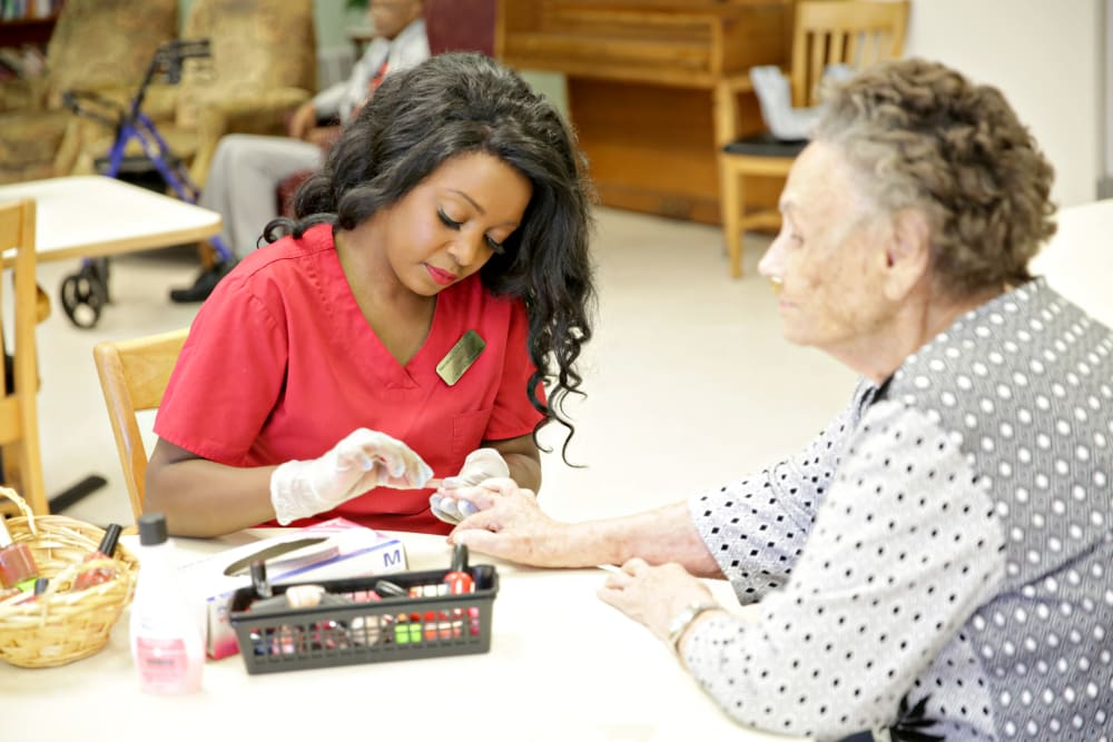 A staff member painting a resident's nails at Providence Assisted Living in Cleveland, Mississippi.