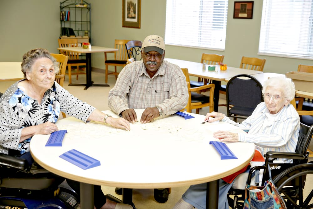 A group of residents playing a card game at Providence Assisted Living in Cleveland, Mississippi.