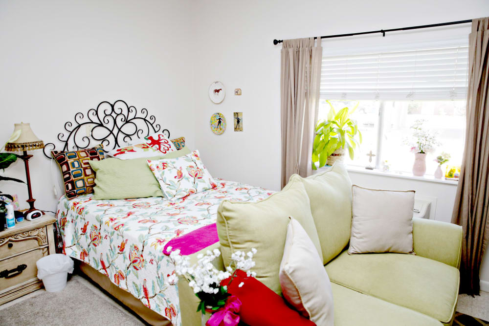 A cozy resident bedroom at Providence Assisted Living in Cleveland, Mississippi.