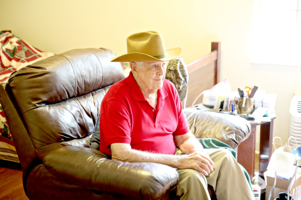 A resident relaxing in a comfy chair at Providence Assisted Living in Grenada, Mississippi.