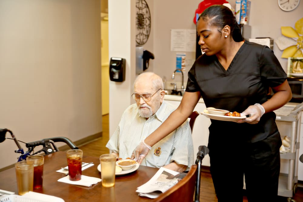 A resident being served food at Providence Assisted Living in Grenada, Mississippi.
