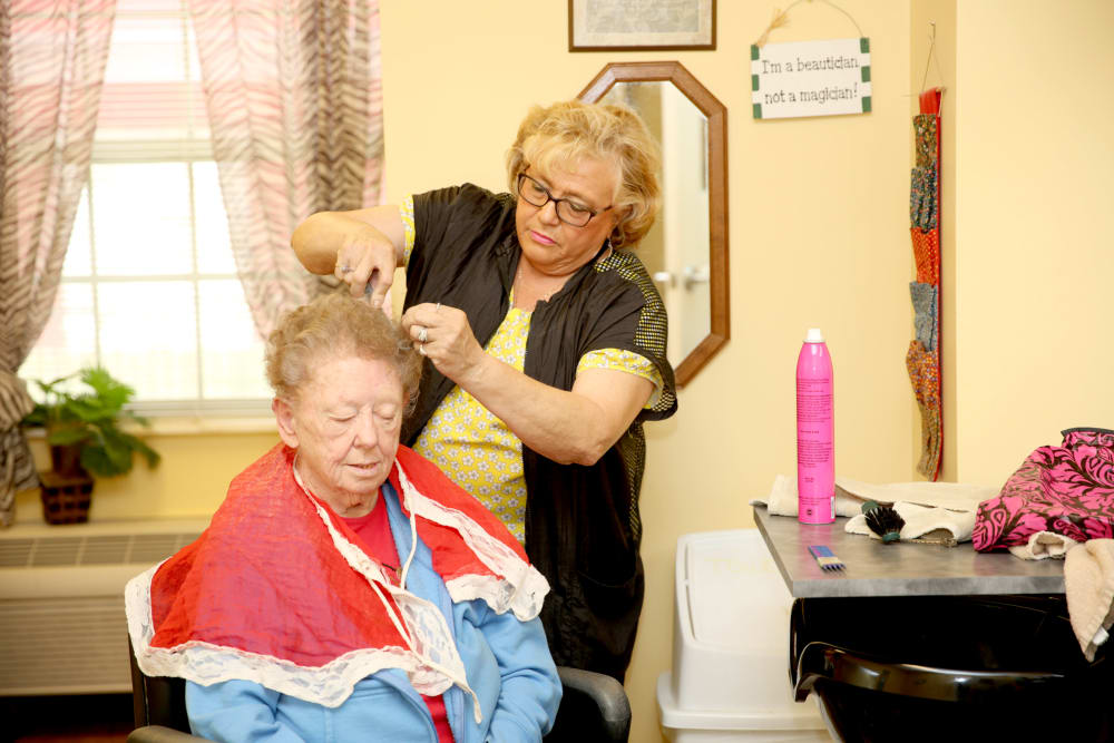 A resident getting her hair done at Providence Assisted Living in Grenada, Mississippi.