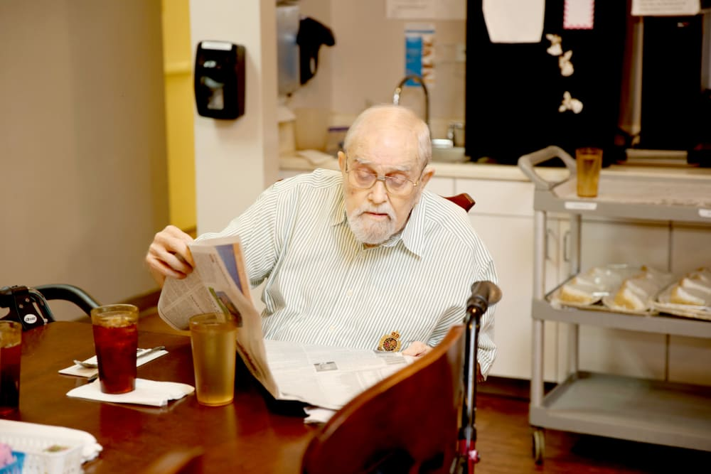 A resident sitting and reading the paper at Providence Assisted Living in Grenada, Mississippi.