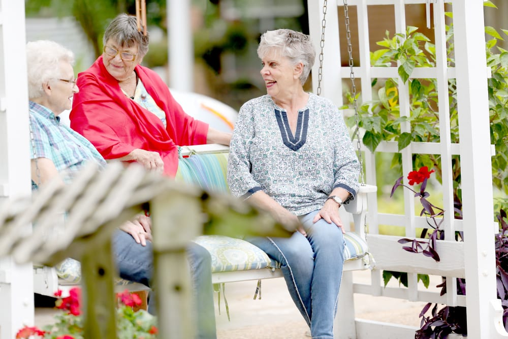 Residents chatting in the garden at Providence Assisted Living in Grenada, Mississippi