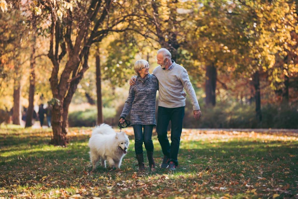 Couple walking their dog in a park near 301 Riverwalk Place in Buffalo Grove, Illinois