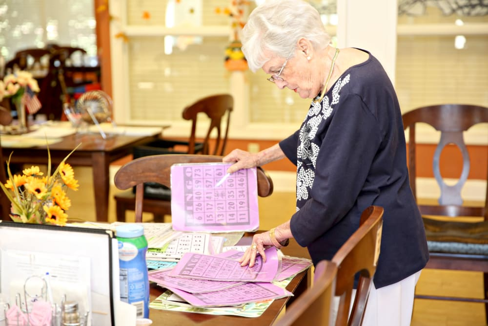 A resident going through bingo cards at Providence Assisted Living in Senatobia, Mississippi.