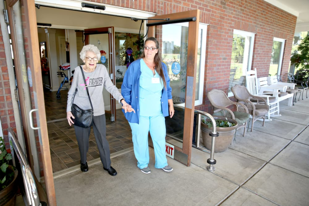 A resident taking a walk with a staff member at Providence Assisted Living in Senatobia, Mississippi.