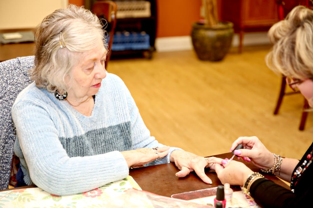A resident getting her nails done at Providence Assisted Living in Senatobia, Mississippi.