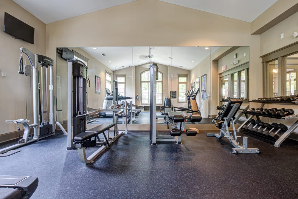 Fitness center featuring free weights treadmills and other equipment at Preserve at Steele Creek in Charlotte, North Carolina