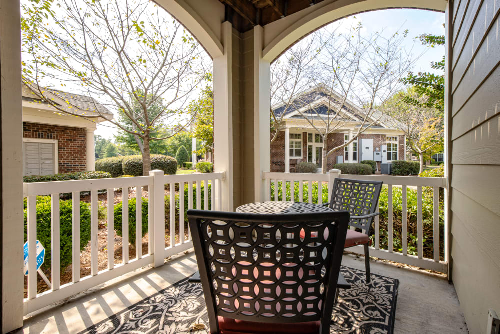 Beautiful porch with chairs at Apartments in Charlotte, North Carolina