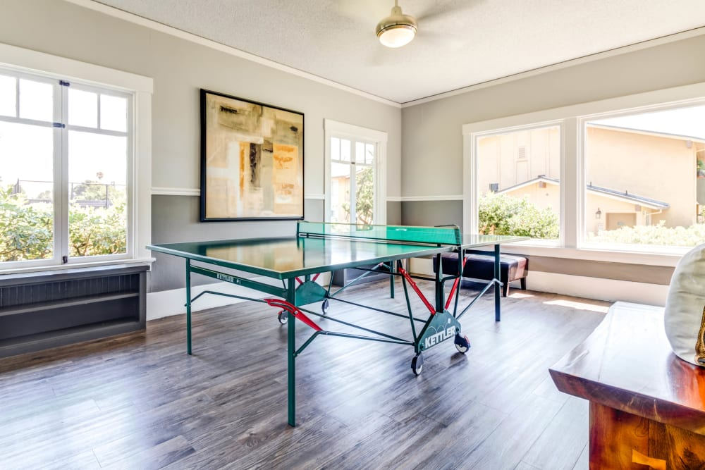 Game room with a ping pong table and more in the clubhouse at The Landmark Apartment Homes in Sunnyvale, California