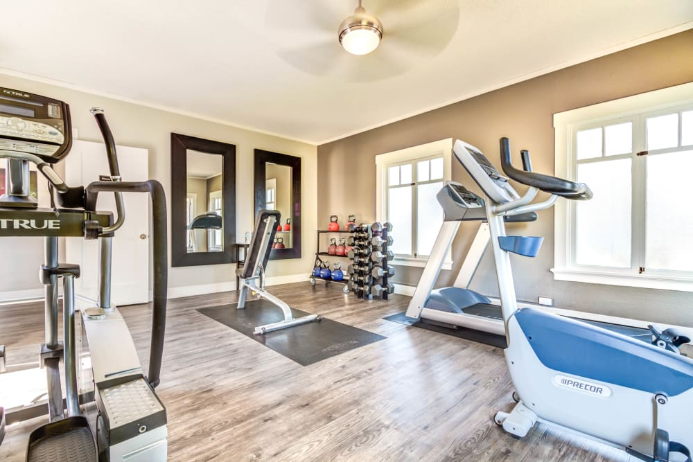 Cardio machines and free weights in the fitness center at The Landmark Apartment Homes in Sunnyvale, California
