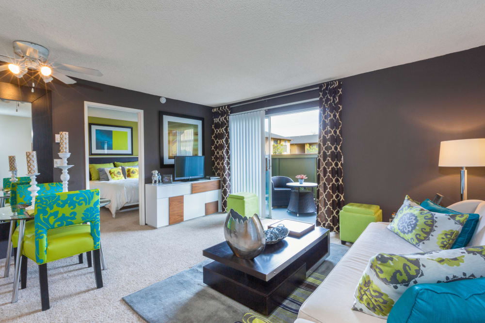 Accent wall and plush carpeting in a model home's living area at The Landmark Apartment Homes in Sunnyvale, California
