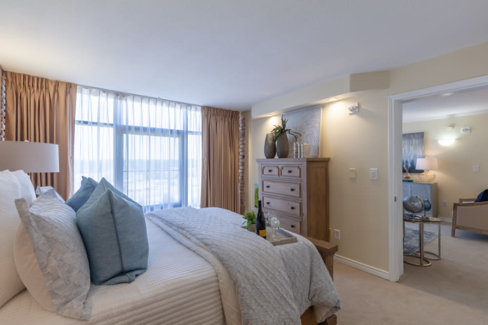 Bedroom and living room at Windsor Senior Living in Dallas, Texas