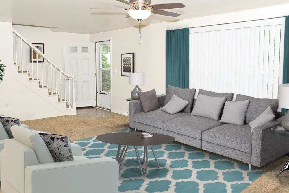Comfy couch at Green Lake Apartments & Townhomes in Orchard Park, New York