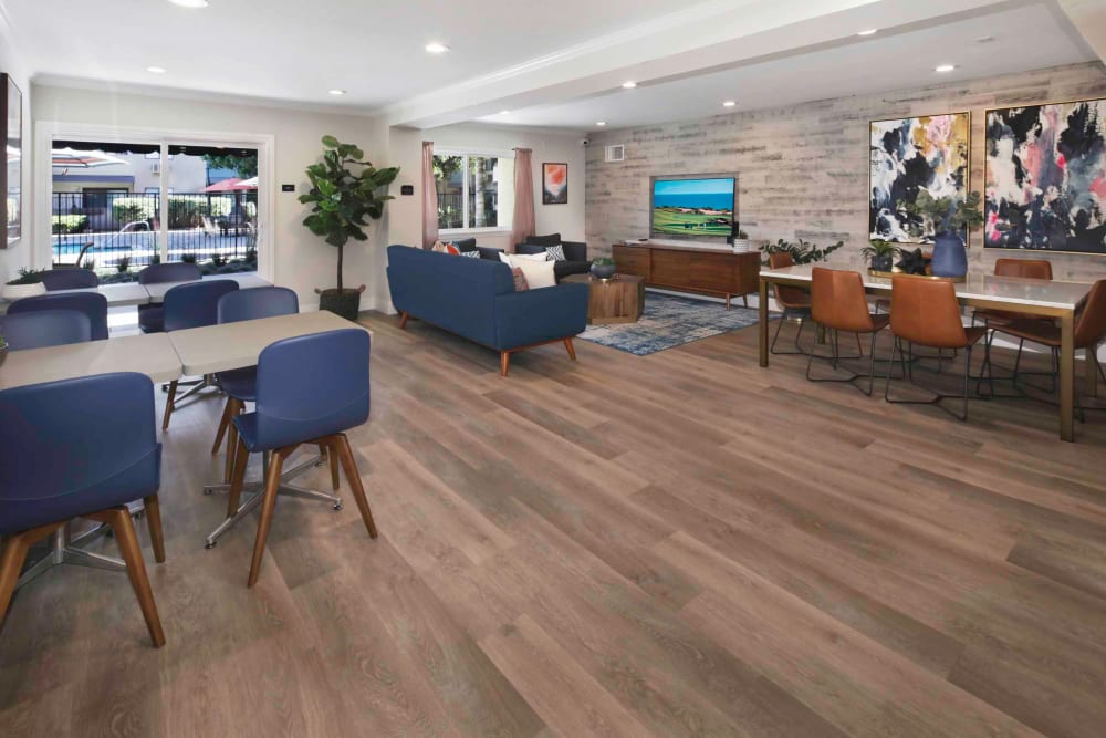 Resident clubhouse interior with hardwood flooring and modern furnishings at Haven Warner Center in Canoga Park, California