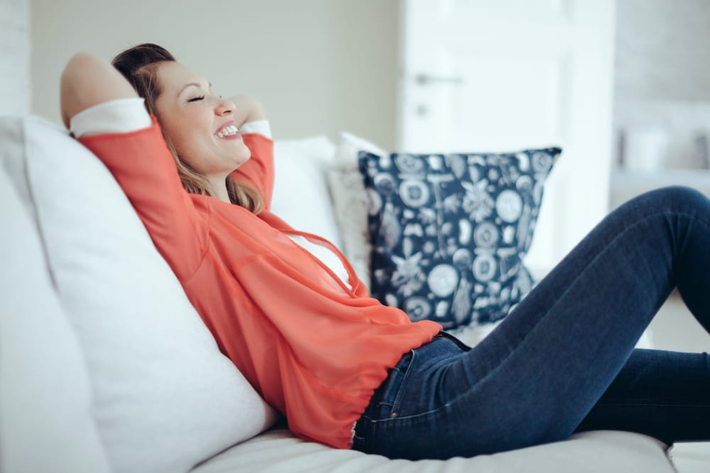 Woman on couch at Avilla Gateway in Phoenix, Arizona