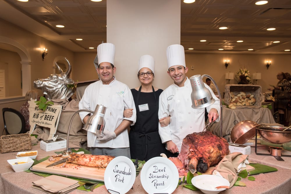 Chefs at a buffet spread at Inspired Living Sugar Land in Sugar Land, Texas.