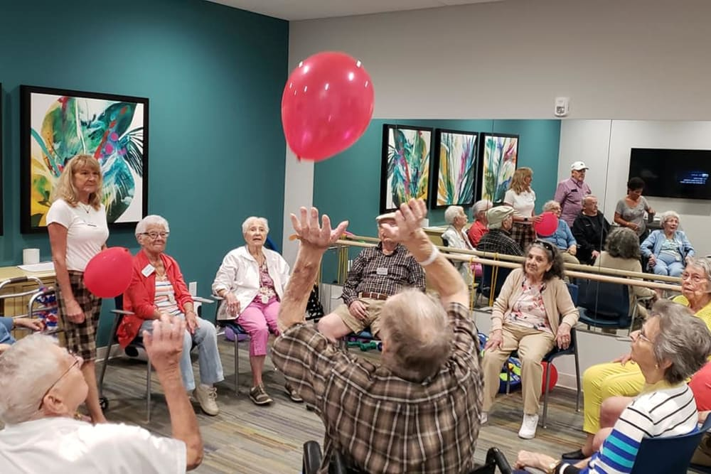 Residents playing with a balloon at Atrium at Liberty Park in Cape Coral, Florida