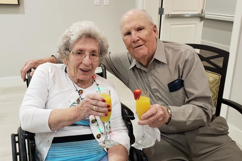 Two residents enjoying drinks at Atrium at Liberty Park in Cape Coral, Florida