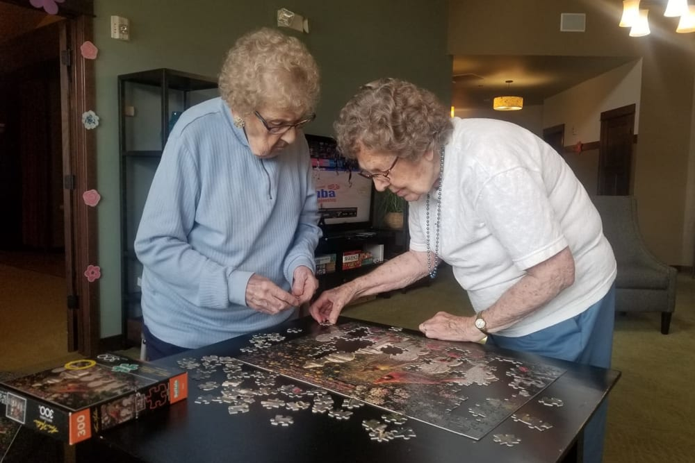 Two residents putting together a puzzle at The Landings of Kaukauna in Kaukauna, Wisconsin