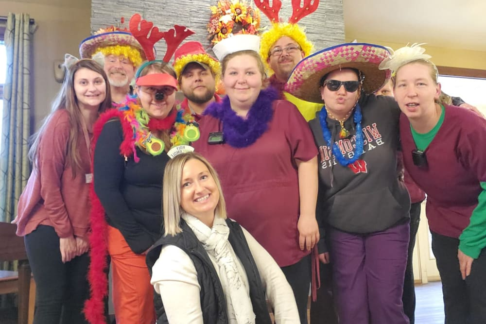 Friendly staff members dressed up for a holiday event at The Landings of Kaukauna in Kaukauna, Wisconsin