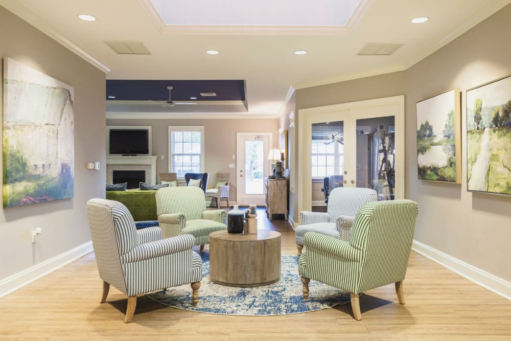Comfortable places to sit and get to know your neighbors in the clubhouse at North Woods in Charlottesville, Virginia