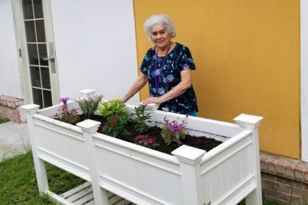 A resident gardening at Gentry Park Orlando in Orlando, Florida