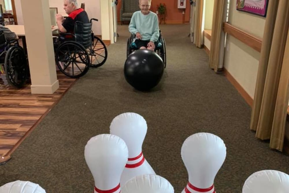 A resident playing giant bowling at Landings of Huber Heights in Huber Heights, Ohio