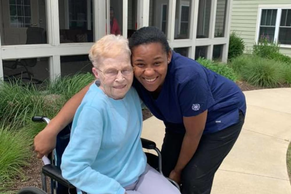 A resident and a staff member at Landings of Huber Heights in Huber Heights, Ohio