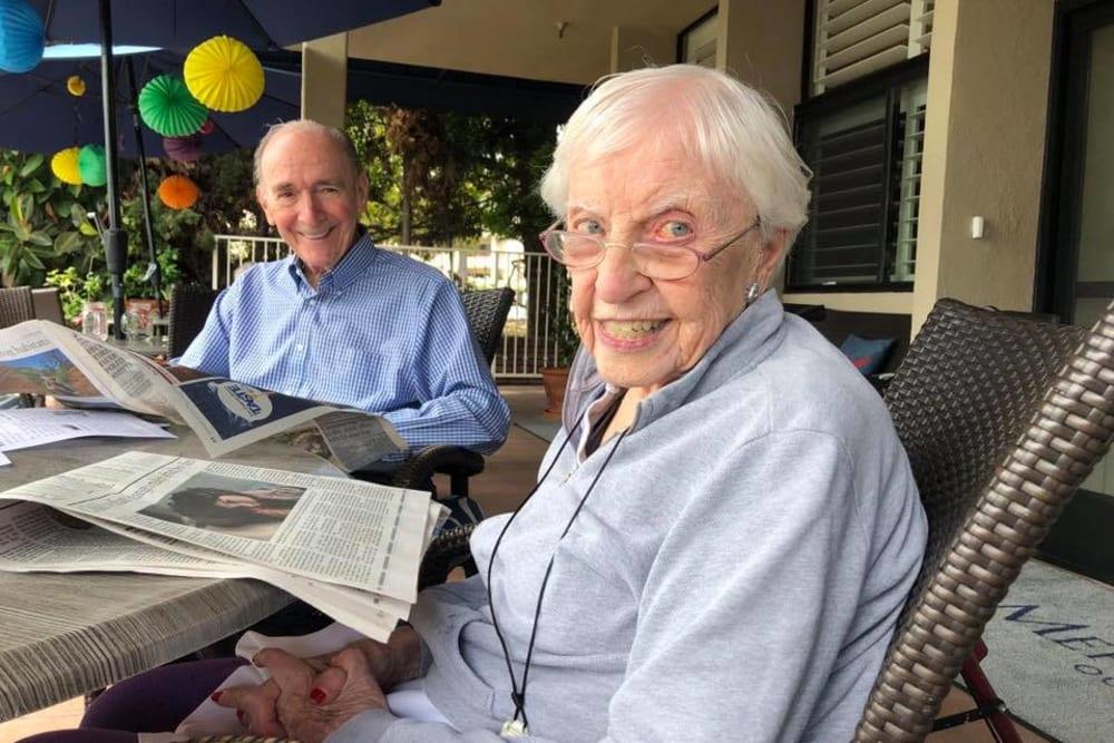 Residents reading the newspaper at Meridian at Ocean Villa & Bella Mar in Santa Monica, California