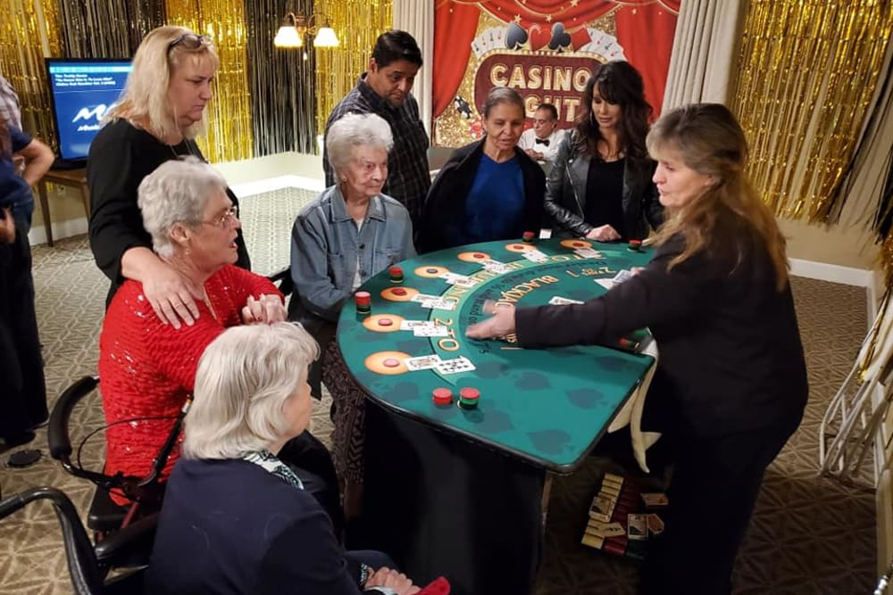 Residents playing poker at Sunlit Gardens in Alta Loma, California